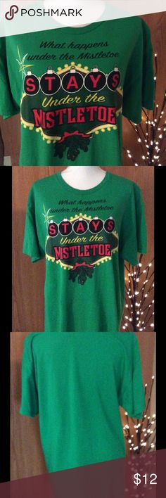 "Green holiday tee shirt with logo size large Holiday logo tee shirt. Green in color with words ""What happens under the mistletoe stays under the mistletoe"" imprinted on it. Perfect to wear with jeans or leggings. Size Large Made out of cotton  Measurements:    Length:  28 1/2 inches  Waist:  22 inches side to side  Bust:  21 inches side to side  Listing:  217 Tops Tees - Short Sleeve"