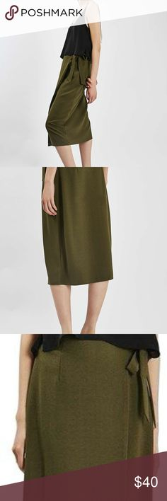 NWOT Topshop Midi Wrap Skirt ALL OFFERS WELCOME!!  This Topshop wrap skirt is perfect for your office job. Waist is adjustable because of the tie, and fabric is just the right amount of stretchy!  Army Green Polyester/Elastane blend.  US Size 2  THIS SKIRT HAS NEVER BEEN WORN Topshop Skirts Midi