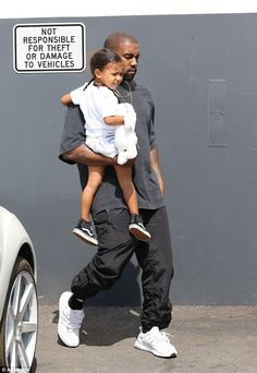 Stylish:North looked stylish and cosy in her jean shorts, white shirt, and black sneakers