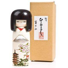 Delighting kokeshi doll