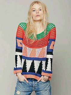 Bold tapestry crochet filet pullover sweater.