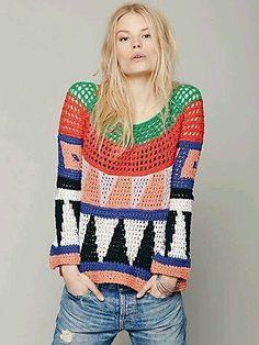 Bold tapestry crochet filet pullover sweater.