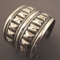 """Silver, Kazakstan   Description  A rare bracelet ( from early 20th century) decorated with embossed silver motives and fine braidings on each side and coming from Kazakhstan ...   Weight:65gr  Height:1,850 inch  Diameter::2,36 inch adaptable www.halter-ethnic.com...see """"My Lucky Finds"""""""