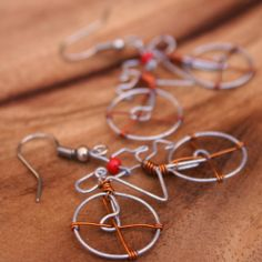 """Fair Trade Wire Bicycle Earrings — handmade in Kenya — find them at Fair & Square Imports — These bicycle earrings are made of steel wire with recycled copper accents. Called """"boda boda"""" by the locals, bicycles are used as public transportation (you ride on a padded rack on the back) and are named for the bikes used to transport people across the border between Uganda and Kenya -- from border to border."""