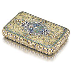 A Russian silver-gilt and cloisonné enamel Imperial Presentation cigarette case, Ovchinnikov, Moscow, 1893, the lid and base each centered with a shaped oval cartouche within leafy tendrils, the interior inscribed: Presented by/ the Tsarevitch/ to/ J. Gwillim,/ July 1893.