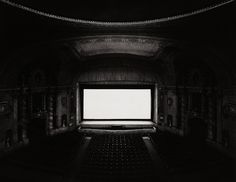 """Hiroshi Sugimoto, THEATERS series: in which he """"..expos[ed] the film for the duration of the entire [movie], the film projector providing the sole lighting. The luminescent screen in the center of the composition, the architectural details and the seats of the theater are the only subjects in the photographs, and the unique lighting gives the works a surreal look, as a part of Sugimoto's attempt to reveal time in photography."""" (via http://en.wikipedia.org/wiki/Hiroshi_Sugimoto)."""