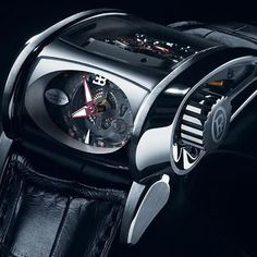 "Parmigiani Bugatti Type 372 ""Super Sport"". Designed to look like a transversal engine, and is mounted in 18 carat gold."