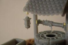 Modélisation et impression 3D d'un puits, de son socle et ses divers accessoires (abreuvoir, lanterne, seau et mécanisme de remonté).  diorama #warhammer #ageofsigmar #wargame #figurine #impression3d #3dprint #3dprinting #formlabs #formone #maquette