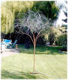 This copper tree sprays water out the top of its branches for a unique and eye-catching sprinkler alternative in your garden or on your lawn. It can also be used as a fountain in a pond when attached to a re-circulating pump. This handcrafted copper tree sprinkler installs simply by pressing the support fork into the ground and hooking up the garden hose. Water coverage is 20 feet in diameter, depending on water pressure. Includes steel fork for anchoring in the ground.