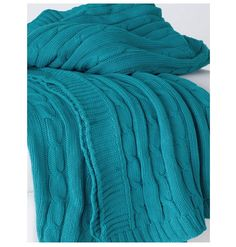 Just like your favorite sweater, our chunky cable knit turquoise throw is meant for staying cozy in stylish comfort. Rich turquoise color makes our cotton throw blanket a chic home accent begging to b