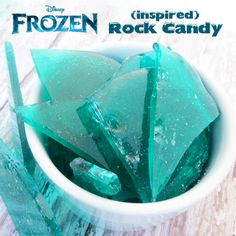 "Disney's Frozen inspired Rock Candy -A fun idea for a ""Frozen"" themed party!  Place 1 cup sugar, 1/2 cup light corn syrup and pinch of salt in a heavy pan. Over low heat, slowly bring mixture to a boil, stirring often.  Let it boil until it reaches 300˚ or hard crack stage.   Remove from heat and add 1/2 tsp peppermint extract and 4 drops neon blue food coloring.  Stir. Poor in a parchment lined pan. Let cool completely. Use your hands or a knife to crack the candy into smaller pieces."