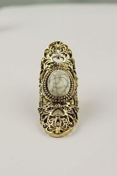 This ring crafted in alloy, featuring rhinestone inlaid cut out detailed design with a chunky shank.$15