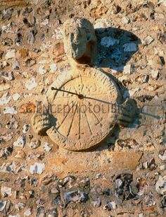 Sundial on the wall of a church North Stoke Oxfordshire