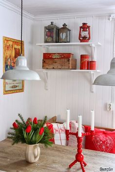 The White Panelling and Red Accented Decor is beautiful!