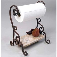 Pictured here is the Bentley Paper Towel Holder with hand-forged wrought iron frame and lower marble shelf. Decor, Wrought Iron Furniture, Marble Shelf, Iron Accents, Towel Holder, Wrought Iron Decor, Home Decor, Iron Decor, Paper Towel Holder