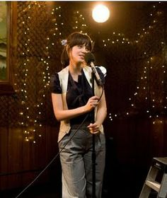 Yes, this is the girl from 500 Days of Summer (which also makes me happy) but what this picture really represents is Karaoke! I love it.  I like trying to sing, and especially love the feeling I get when I sing a song well.