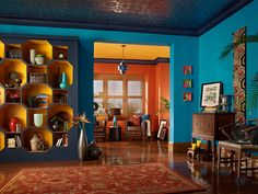 Artisan Voyage : This living room has an eclectic ambiance filled with cultural influences and color richness. Room Paint Colors, Paint Colors For Living Room, Paint Colors For Home, House Colors, Wall Colors, Painting Shelves, House Painting, Home Confort, Deco Orange