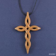 Celtic Cross  This cross pendant, carved from Mbete wood, twists in a pattern inspired by the Celtic knot. #FairTrade www.serrv.org