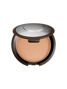 """25,000 compacts of this limited-edition luminizer sold in its first 20 minutes on sephora.com (it's now back in stock, thankfully). So what makes the highlighter so damn good? The iridescent peach tone achieves the impossible: It works on every skin tone (and by """"works,"""" we mean it looks totally natural). """"When you look at the color peach, it's a mix of pink and yellow,"""" says Becca makeup artist Kerry Cole. """"When those two colors are blended together, you get a shade that neutralizes your…"""