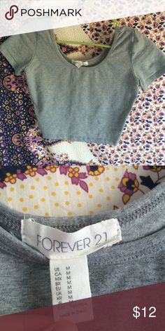 Gray crop top Gray crop top that's very cute and looks cute with any outfit you put it with Forever 21 Tops Crop Tops