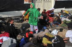"""Pulitzer for Breaking News Photography - """"Awarded to Massoud Hossaini of Agence France-Presse for his heartbreaking image of a girl crying in fear after a suicide bomber's attack at a crowded shrine in Kabul."""""""
