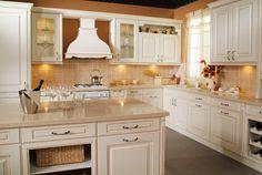kitchen color idea - copper/beige with white cabinets