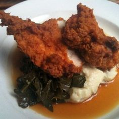 South City Kitchen - Midtown - Atlanta, GA, United States. Buttermilk Fried Chicken with collard greens over garlic mashed potatoes