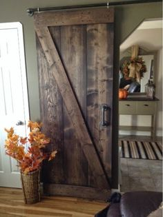 I love the look of barn doors. My sister had two grand barn doors installed in her new home with authentic hardware and they look gorgeous....