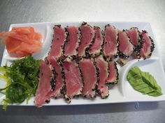 You will love this pan-seared sesame crusted yellow fin tuna, sliced thin and served with wakame seaweed salad, wasabi and pickled ginger.