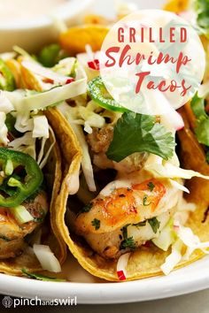 An easy recipe for Grilled Shrimp Tacos with cabbage slaw and a creamy spicy sauce. Corn tortillas are lightly charred on the grill while shrimp are tossed in a spicy marinade and grilled to perfection. One of those healthy recipes you'll return to all summer long! Seafood Recipes, Appetizer Recipes, Mexican Food Recipes, Mexican Dishes, Seafood Dishes, Thai Recipes, Fish Recipes, Healthy Grilling Recipes, Cooking Recipes