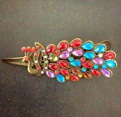 Hey, I found this really awesome Etsy listing at https://www.etsy.com/il-en/listing/239235239/multicolored-peacock-hair-clip-wedding