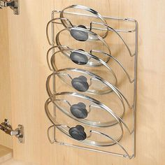 Our pot lid rack adopts heavy-duty iron steel materials and premium chrome finish process sturdy durable sleek and not easy to rust. And coming with 5-layer separate slot with a U-shaped groove in the middle it can organize 5 pot lids orderly and firmly. Additionally its mounting design allows it can be mounted on a wall or behind cabinet doors to fully and reasonably make use of empty space in your kitchen. Features Sturdy and Durable: Adopting heavy-duty iron steel materials and premium… Pot Lid Storage, Pot Lid Organization, Pan Storage, Lid Organizer, Diy Kitchen Storage, Kitchen Decor, Kitchen Rack, Organizing Kitchen Cabinets, Small Kitchen Organization