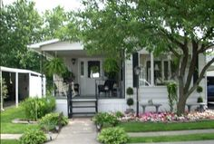 Romantic cottage style mobile home with charming porch - Mobile Home Living