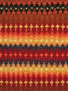 Krokbragd with brilliant oranges on an upright two-shaft tapestry loom, using additional heddle rods to create extra sheds by Sharon Marquardt of Henning, Minnesota.