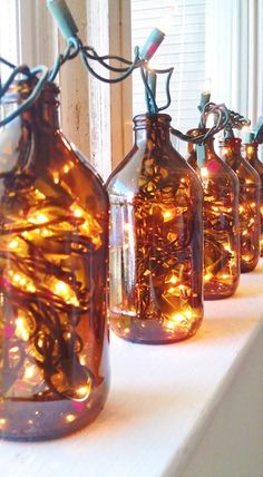 I have lots of brown bottles with the flip tops.might work with those. Definitely for the beer garden. Brown Bottles, Amber Bottles, Wine Bottles, Fairy Lights, Christmas Lights, Christmas Beer, Beer Bottle Lights, Bottle With Lights, Beer Bottle Crafts