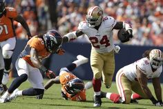 San Francisco 49ers running back Anthony Dixon (24) runs against Denver Broncos defensive back David Bruton (30) during the second half of an NFL preseason football game in Denver, Sunday, Aug. 26, 2012. (AP Photo/Joe Mahoney) Photo: Joe Mahoney, Associated Press / SF