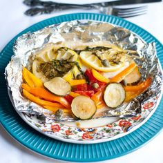 Grilled Lemon Tilapia in a Foil Packet 4 tilapia fillets (I used frozen...I know, I know) 1 large lemon or 2 smaller lemons, thinly sliced 2 Tablespoons butter 1 zucchini, thinly sliced 8 mini bell peppers, sliced (Or 1 regular bell pepper) 1 slicer tomato, chopped 1 Tablespoon capers, juice drained 1 Tablespoon olive oil 1 teaspoon Kosher salt ¼ teaspoon black pepper Small bunch fresh dill Salt Pepper Cooking spray Foil