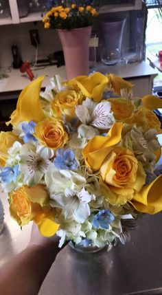 Bridal bouquet - white hydrangea, yellow roses, yellow mini calla lilies, white alstromeria, light blue delphinium #columbusweddingflowers #griffinsfloral