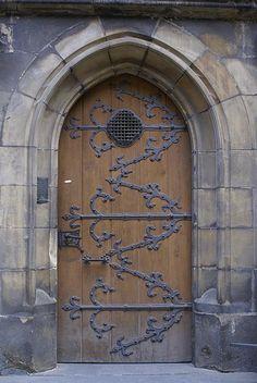 Wood door. Iron detailing. Prague.