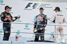 Nico Rosberg (right), spraying champagne on the podium, has the title race momentum...