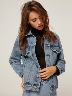 Introducing Reformation Jeans. This is a hip length, denim jacket with chest and side pockets.
