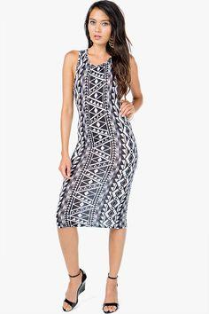 A bodycon dress with an eye-catching tribal printed body. Midi length. Racerback.