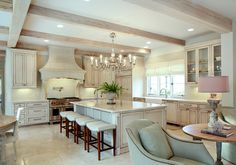 French Kitchen Ideas. French kitchen with creamy white cabinets. Antique white kitchen cabinet