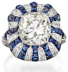 Art Deco diamond and sapphire ring, circa 1920. Via Diamonds in the Library. This certainly works for me!! - MCG