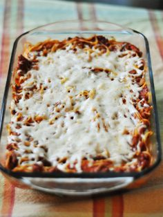 My husband would live off of spaghetti if I would make it every day. But after making it (A LOT) for close to thirteen years, it's not my fave. At all.  I recently decided to try baked spaghetti. So.much.better. I'm sure there are more technical ways of making it but if you are looking