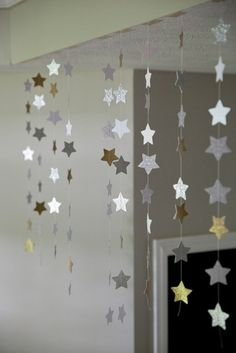 Hanging star decorations - string, star paper cutouts and some tape are all that's needed to make these eye catching decorations.