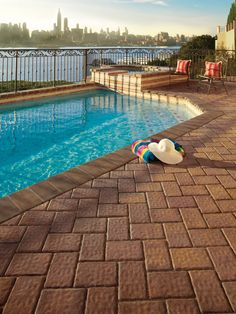 Beautiful Cambridge Pavingstones With Armortec Pool Patio.