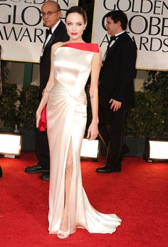 """In Versace at the Golden Globes, 2012  """"She's so beautiful in this that if you look at her for too long, it's sort of like staring at the sun. It's the perfect blend of creamy glamour and modern slashes of red.""""   - ELLE.com"""