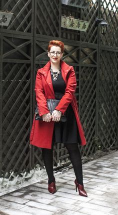 Little black dress and a red coat on top