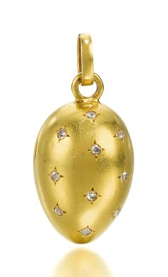 An antique Russian jewelled gold egg pendant/locket, circa The polished surfaces inset with rose-cut diamond stars, the two halves hinged at the side, gold loop.